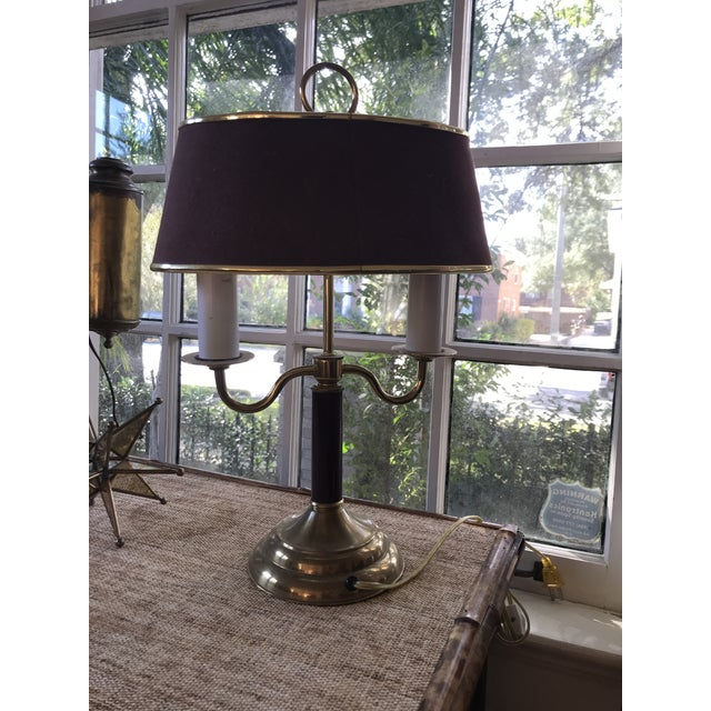 Lovely small bedside or desk lamp in the classic French bouillotte style with two candles and an antique brass finish....