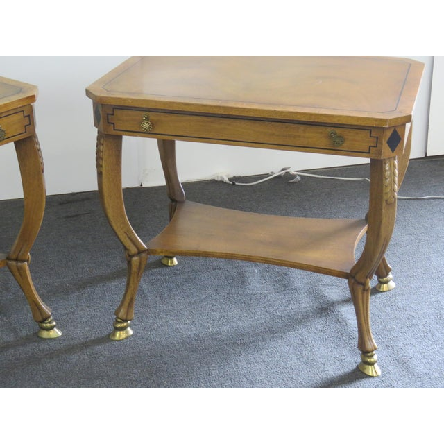 Pair of Regency style paint decorated end tables with 1 drawer and brass feet.