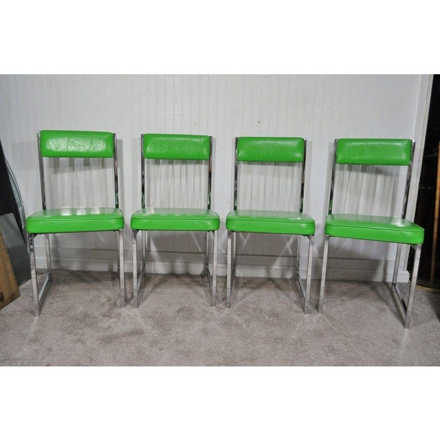 ITEM DETAIL: This auction is for a Unique Vintage Mid Century Modern Lucite and Chrome Dining Set Consisting of 4 Chairs...