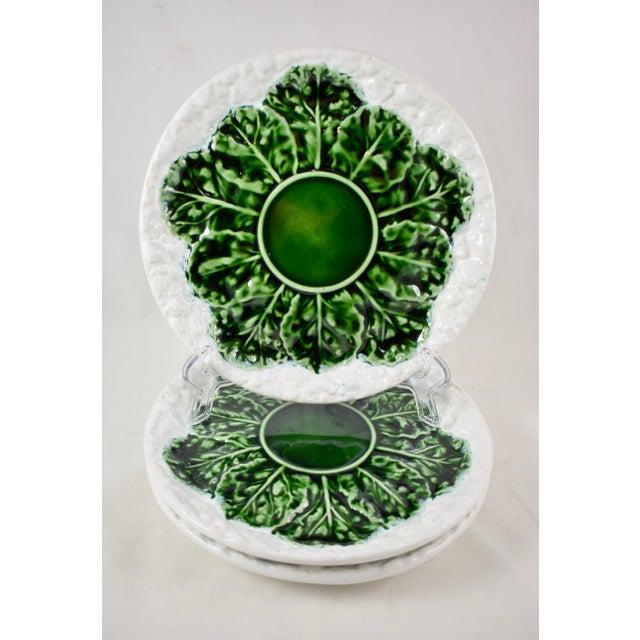 A Mid-Century majolica, green and white glazed cauliflower form plate, marked Bordallo Pinheiro Caldas da Rainha, Made in...