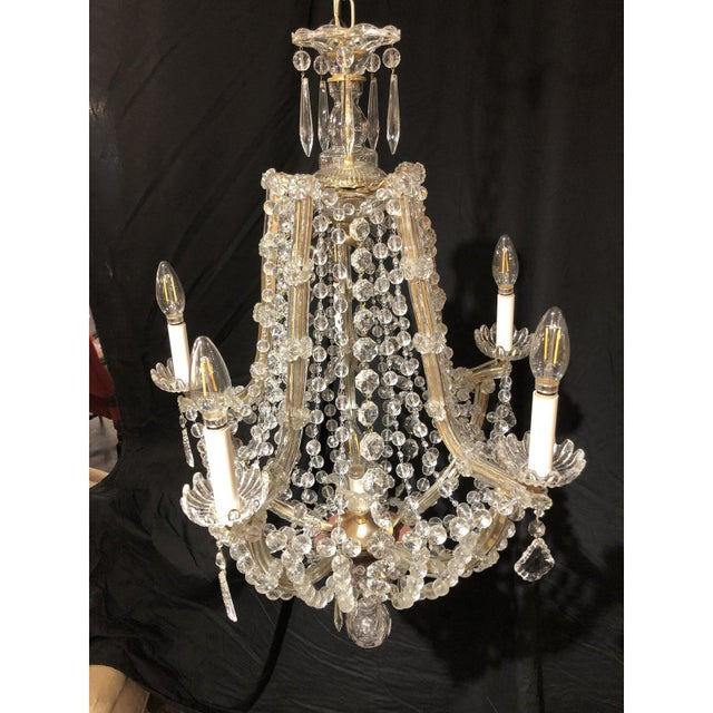 Light and airy, this beautiful chandelier evokes the best of the Louis XVI style. Wonderful piece that can complete any...