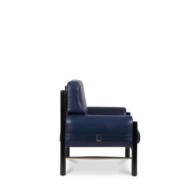 Inspired by the cultural icon James Dean, this leather upholstered armchair has a slender boxy look and curvy arms, and...