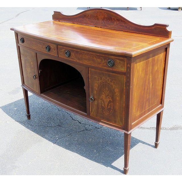 English inlaid server with 2 drawers over 2 doors attributed to Edwards & Roberts.
