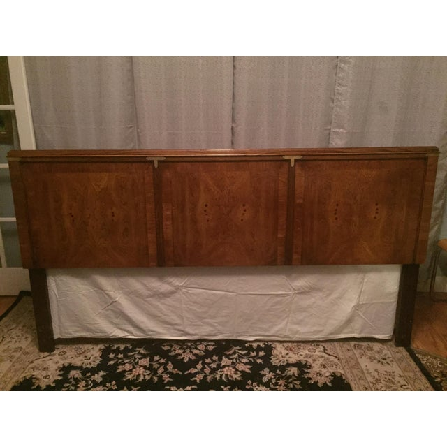 Classic campaign style walnut king size headboard with beautiful burled wood veneer front panels with a solid ash or...