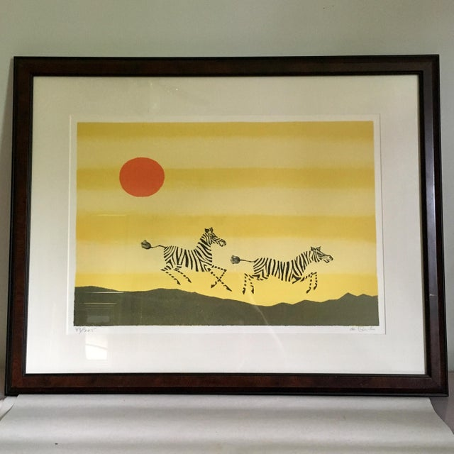 Framed lithograph of zebras and safari by Keith DeCarlo. Pencil signed and 43/275 edition. Minor wear consistent with age.