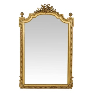French Richly Carved Giltwood Mirror With Ribbon and Pine Cone Carving For Sale