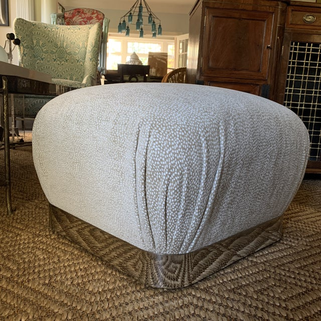 Karl Springer Style Chrome and Velvet shuffle Pouf Ottoman. Newly upholstered in a Luxe beige and white velvet fabric....