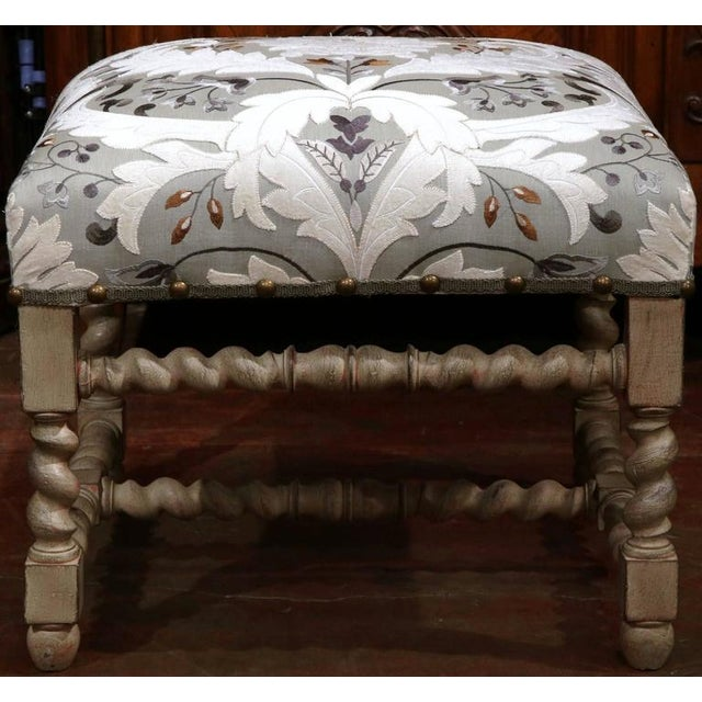 Large antique barley twist painted stool from France, circa 1920 in the Louis XIII style. Recovered with embroidered...