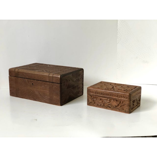 This wonderful pair of complimentary wooden carved boxes were made in England during the latter part of the 19th Century....