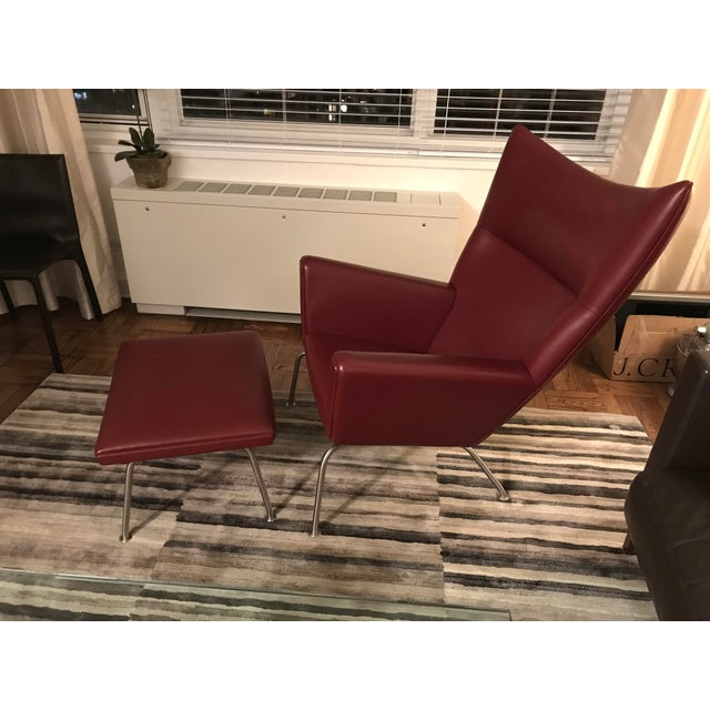 Hans J. Wegner for Carl Hansen & Søn Burgundy Wingback Chair and Ottoman For Sale - Image 5 of 11