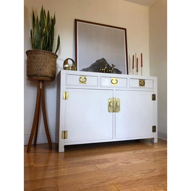 Now available is this stunning and regal campaign buffet, credenza, or sideboard by John Stuart. This completely solid...