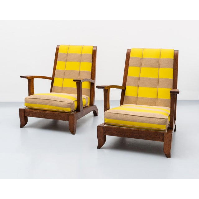 A handsome pair of 1930s French lounge chairs in oak and a stunning Raf Simons fabric. In the manner of Rene Gabriel,...