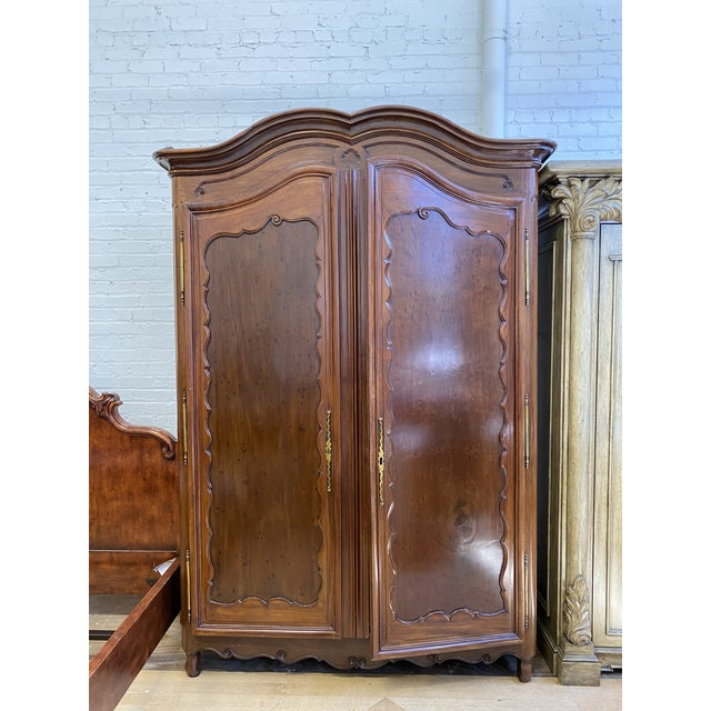 Design Plus Gallery presents an Early 20th-Century French Storage Armoire. Classic armoire form showcases the usual...