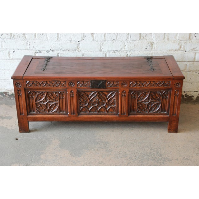Offering an exceptional Belgian Gothic Revival carved oak blanket chest or coffer. The chest features beautiful Gothic...