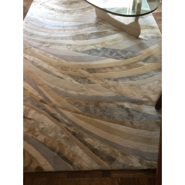 6' x 9' silk and wool stark carpet in perfect condition. No pulls, stains, scuffs. Colors are soft shades of beige (like...