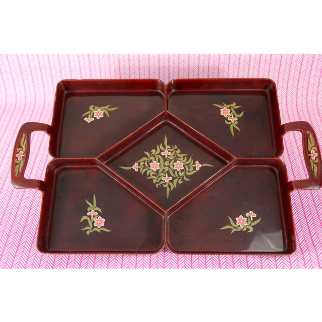 A rare Maruni Lacquerware tray with five compartments. Made of metal and lacquered in a deep red/cinnabar color, with...