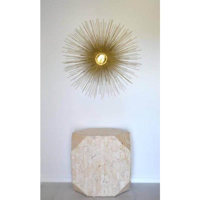 Striking Postmodern tessellated stone pedestal, circa 1970s. This exquisite fossilized pedestal or console table is...