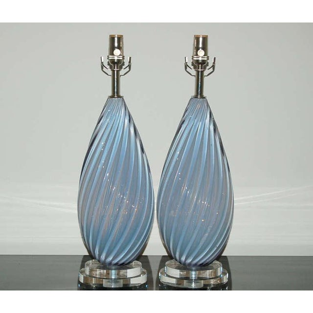 A perfectly matched pair of vintage Murano glass table lamps. Heavily ribbed lamps in soft lavender opaline, circa 1950s....