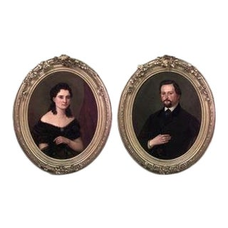 Pair of American Victorian style gilt framed oval oil painting portraits of man with mustache and lady in black lace For Sale