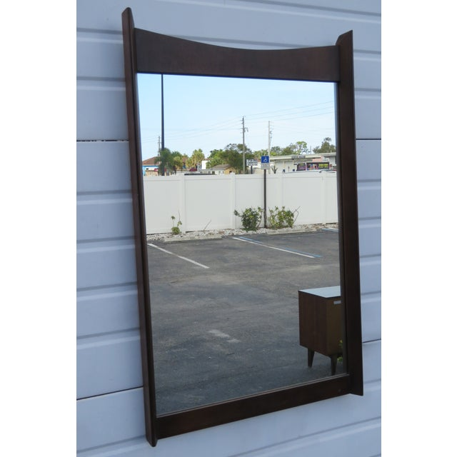 This gorgeous Mirror is made out of wood, solid wood, walnut veneer, and mirror, and is in good condition. This Mirror is...