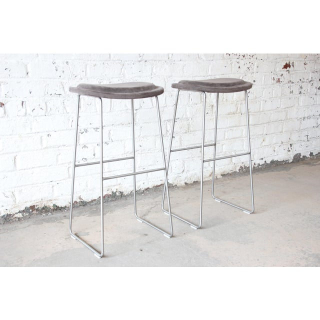 Offering a very nice pair of gray upholstered tall bar stools by Cappellini. The stools have a nice gray upholstery and...