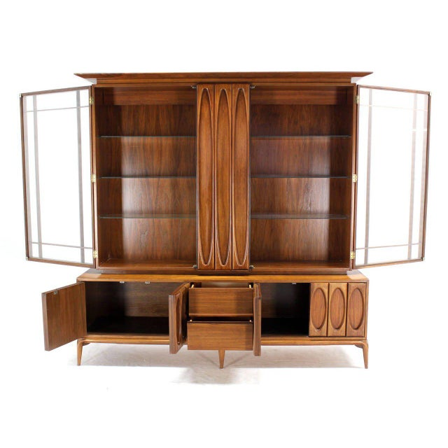 Outstanding mid-century Danish modern heavily carved breakfront or china cabinet. Excellent vintage condition. This is a...