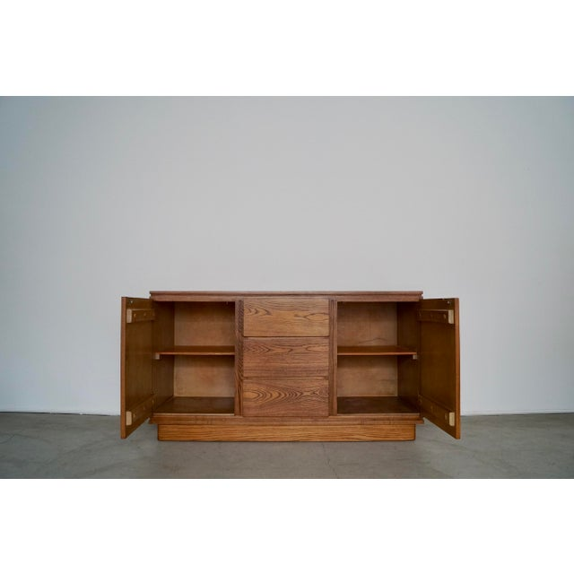 We have this designer Mid-century Modern / Art Deco sideboard for sale. It's constructed of solid ash, and has been...
