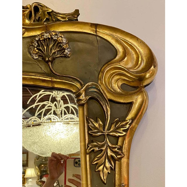 Belle époque style wall or over mantel mirror. This absolutely stunning Art Nouveau form wall mirror is paint and parcel-...