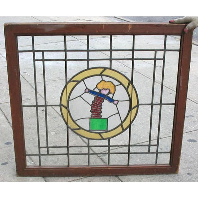 Late 20th century leaded window with stained-glass roundel depicting a jack-in-the-box. A fine example of contemporary...