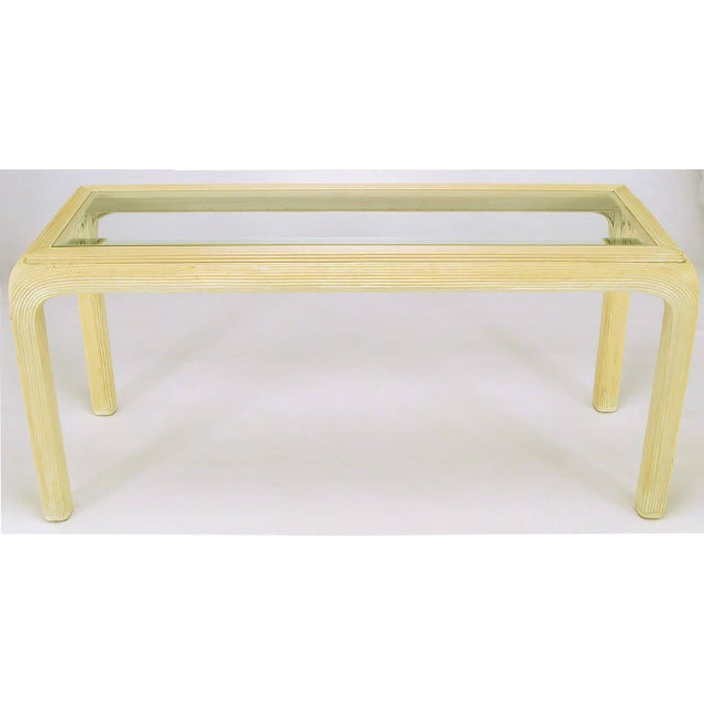 Art deco revival reeded rattan console table with radiused corners and beveled glass insert top. See our listings for...