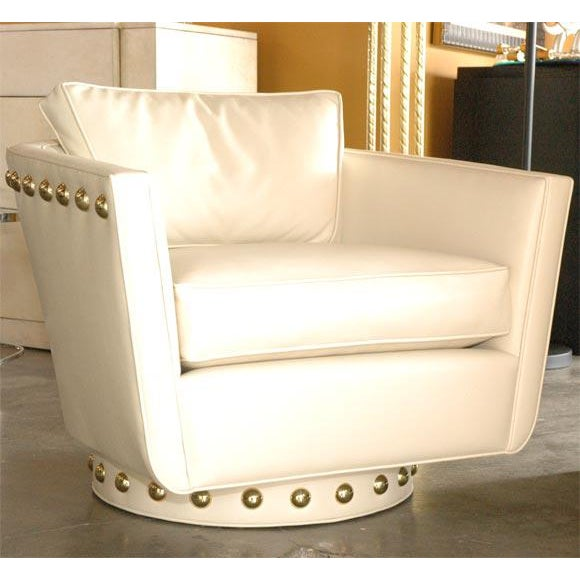 Paul Marra Swivel Lounge Chair, fully upholstered swiveling tub chair with custom over sized brass nail head, shown in...