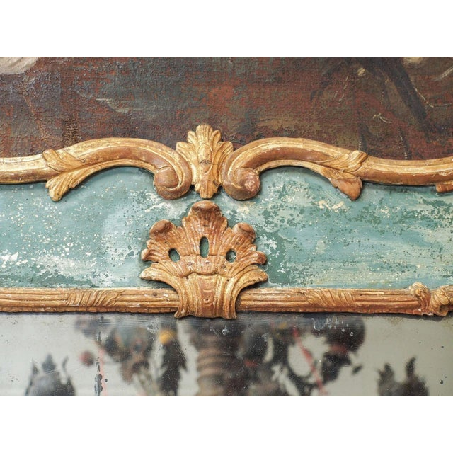 An 18c trumeau with a cartouche of an oil on canvas painting. This mirror is a fine example of the decoration which...