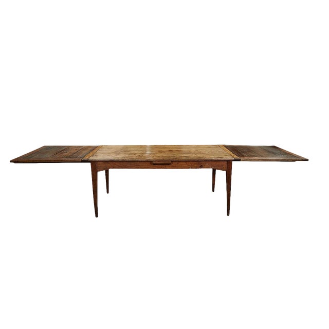 This French Country dining table is a great example of rustic french furniture from the early 19th century. It has two...
