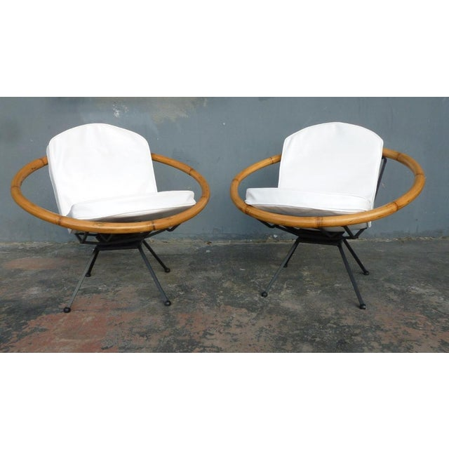 Rare Mid Century Flying Saucer Ritts Tropitan Rattan and Iron Patio Chairs Restored sold as found in vintage condition.