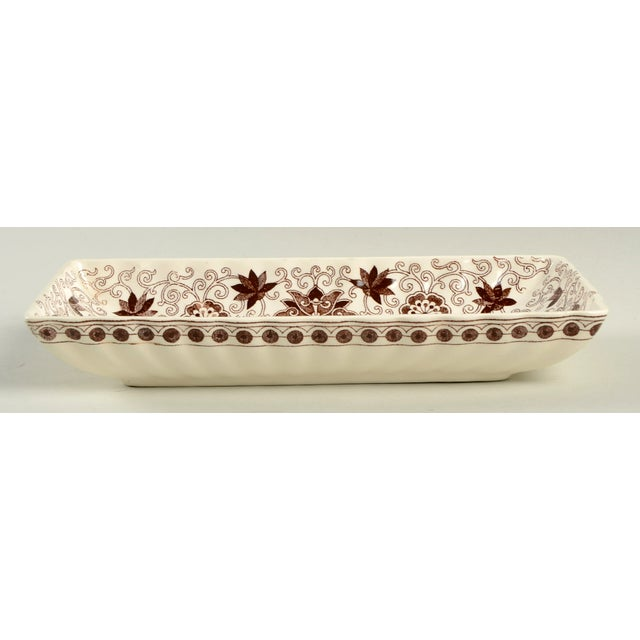 Mason's Bow Bells Brown Tray features brown transfer flowers and scrolls and a scalloped edge. There is a small nick on...