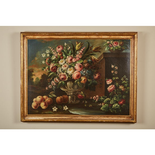 A 19th century Italian school life large oil-on-canvas painting within a gilt wood frame painting depicts a vase with a...