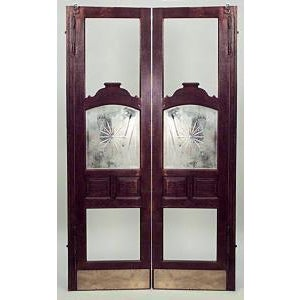 Pair of American Victorian oak full length saloon doors with bevelled glass center (PRICED PER PAIR) 2 pairs available