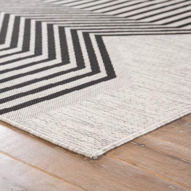 Bold and graphic, the Decora Minya area rug by Nikki Chu offers compelling geometric appeal to indoor and outdoor spaces....
