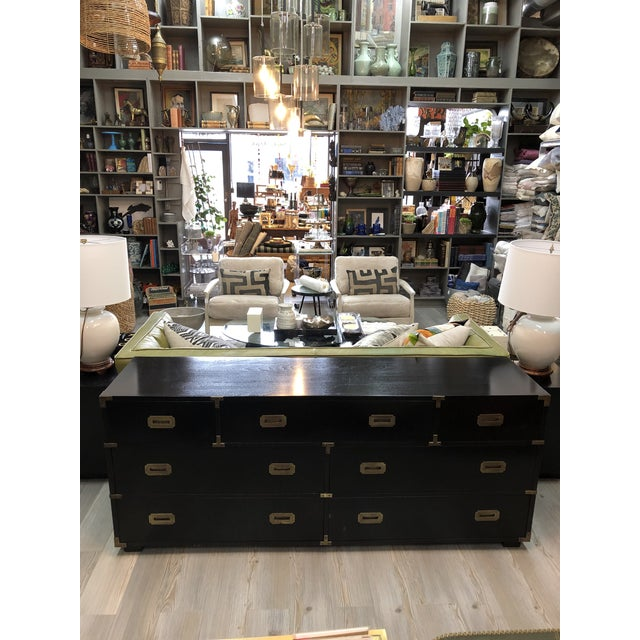 This handsome black Campaign style chest of drawers by Lane has brass inset handles and corner plates, seven oak drawers...