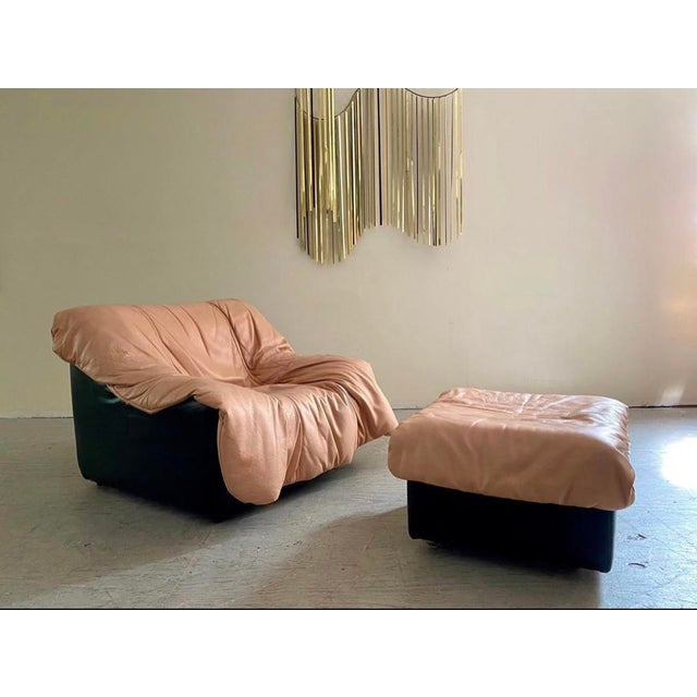 This set features a flowing muted rose leather upholstery which sits on top of a thick leather & foam base. This set...