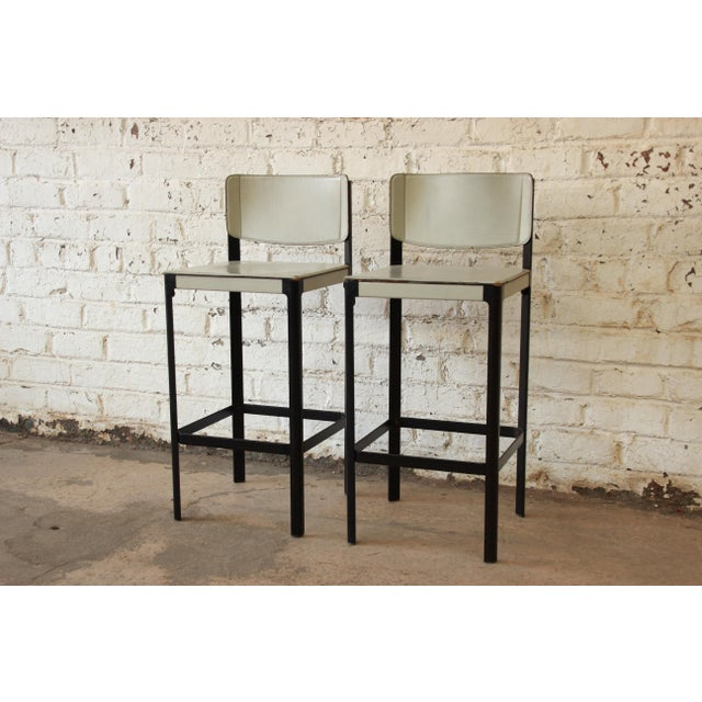 Offering a stunning pair of Sistina Italian leather bar stools by Matteo Grassi. The stools are upholstered in hand-...
