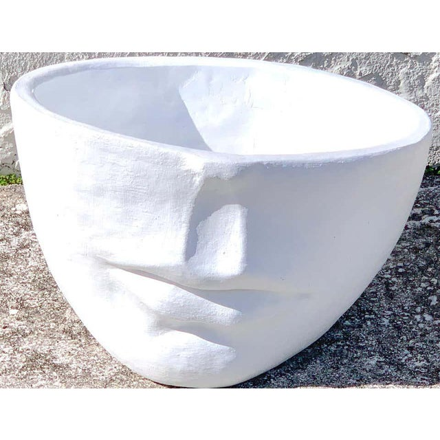 Modern cast stone half face planter, sculptural and sturdy. Ready to place.