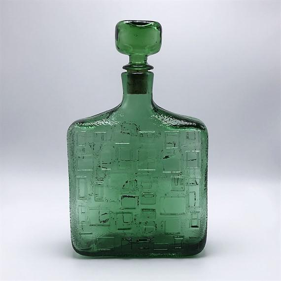Green glass decanter with stopper, c. 1970.