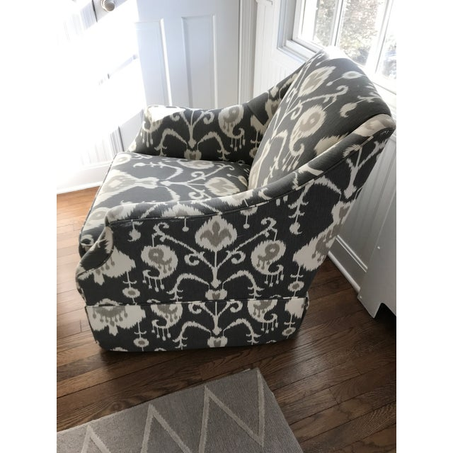 Ikat swivel Glider with lite wear. Small little tear on right side of arm. Bought for a baby's nursery thinking it was for...