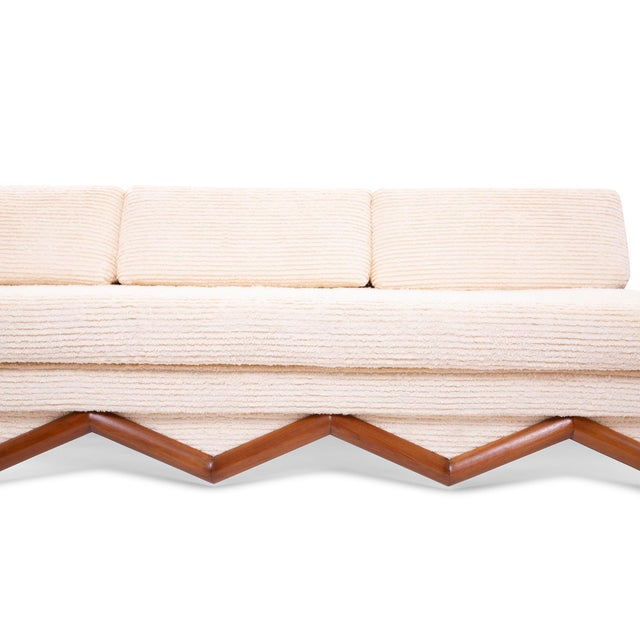 Adrian Pearsall sculpted walnut and upholstered sofa circa mid 1960's. This incredible example has built in walnut side...