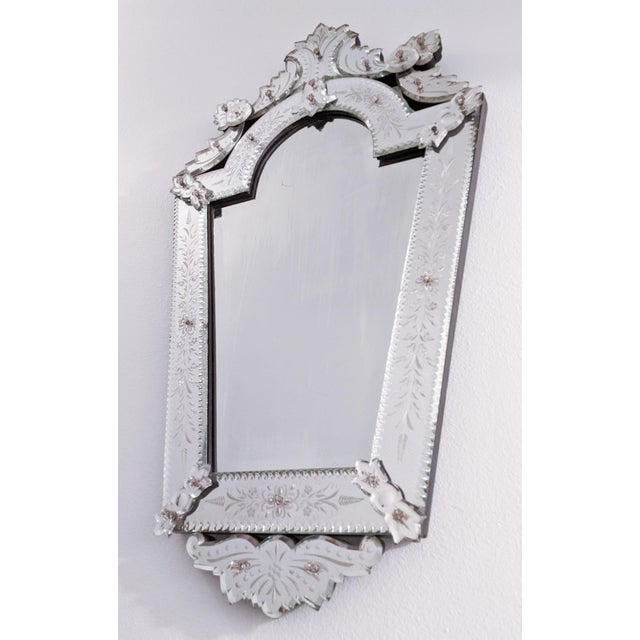 Absolutely stunning ornate etched wall mirror. Multiple scroll details surround this gorgeous and bright piece on the...