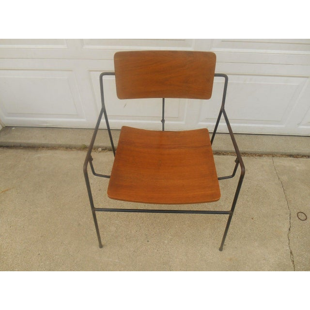 Very rare, original Mid-Century, 1950s-era Arthur Umanoff swing chair composed of wrought iron and walnut. I can't find a...