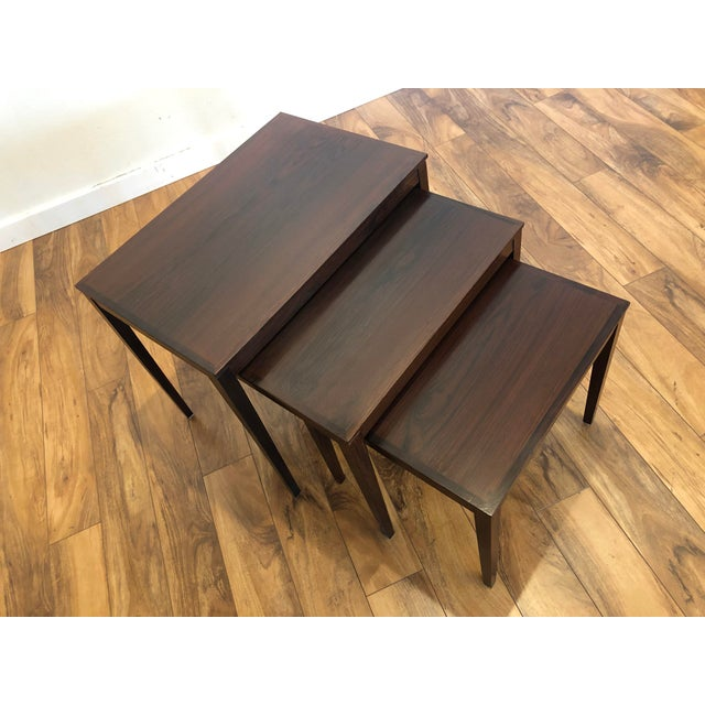 Set of three vintage rosewood nesting tables by Bent Silberg Mobler of Denmark. This lovely Danish Modern nest of tables...