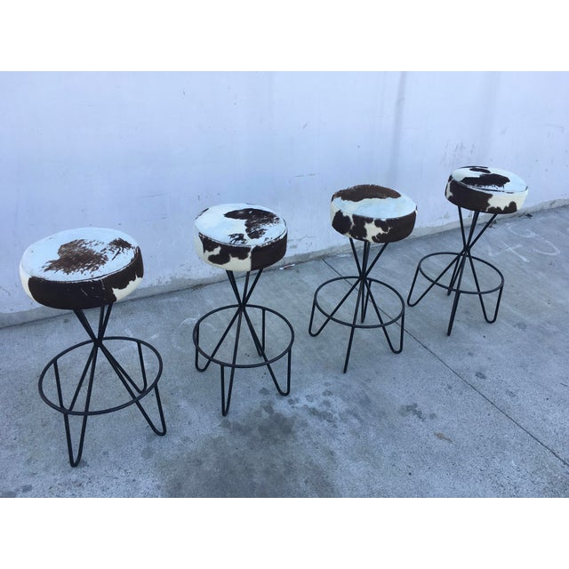 Wonderful set of four iron barstools designed by Paul Tuttle for Modern Color Inc. Southern California mid-century design...