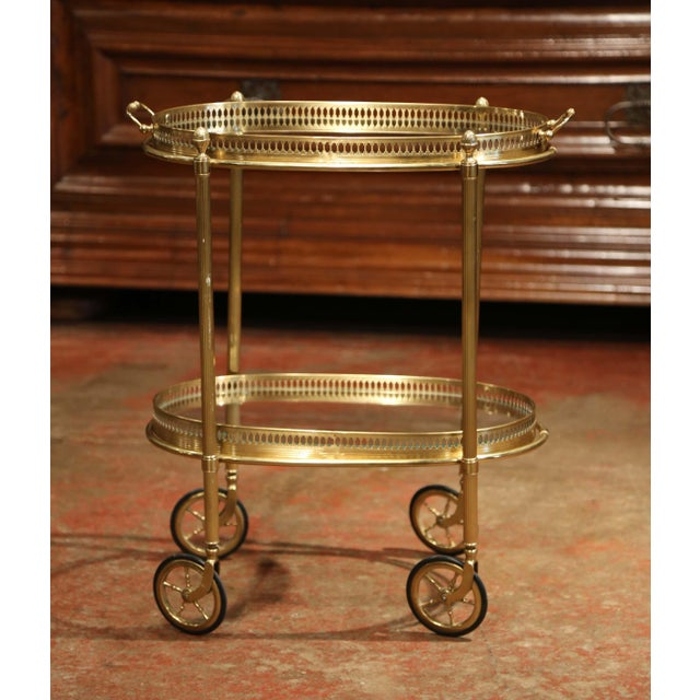 This beautiful, vintage two-tier rolling bar cart was created in France, circa 1930. The dessert table has a brass frame,...